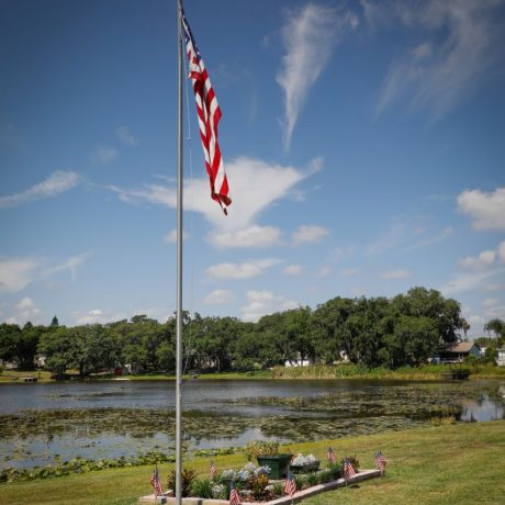 aerial view of lake and American flag